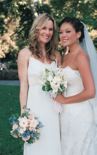 bridesmaid-in-white-dress-with-bride-outside