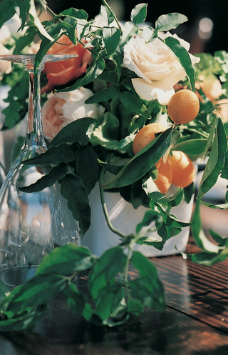 short-floral-centerpieces-on-wooden-tables