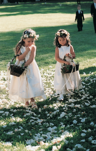 little-girls-carrying-baskets-and-wearing-flower-crowns