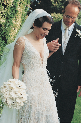 low-cut-ivory-lace-wedding-dress-with-feathers