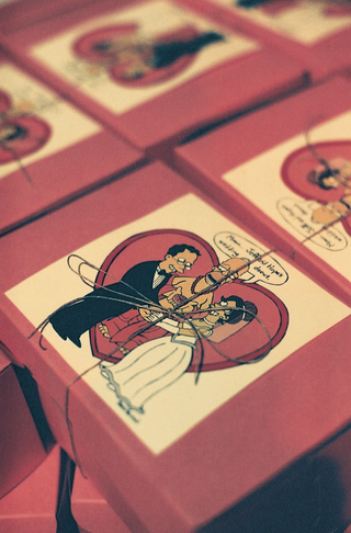 red-wedding-favor-boxes-with-cartoon-and-twine