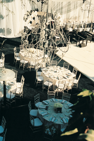 round-tables-and-grand-piano-below-large-chandelier