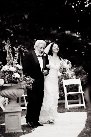 black-and-white-photo-of-bride-in-a-claire-pettibone-gown-walking-down-the-aisle-with-her-father