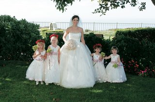 bride-with-flower-girls-in-white-ball-gowns-and-flower-crowns-and-wands