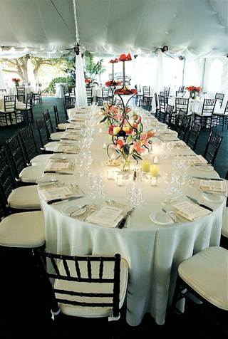 oval-table-with-white-linens-and-colorful-flowers