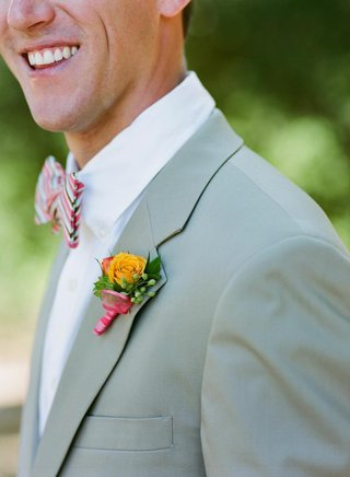 groom-wearing-colorful-flowers-and-bow-tie