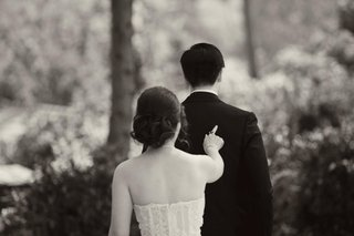 black-and-white-photo-of-bride-poking-grooms-back