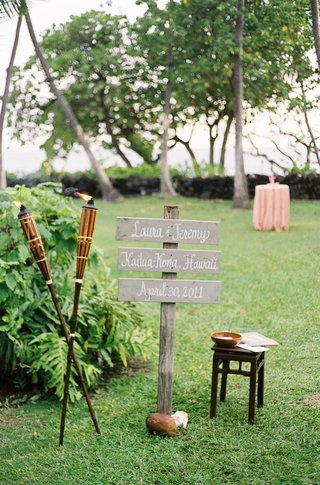 tiki-torches-and-wood-signage-in-grass