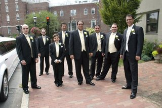 groom-with-groomsmen-in-yellow-vests