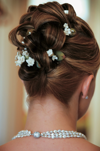braided-updo-hairstyle-studded-with-tiny-flowers