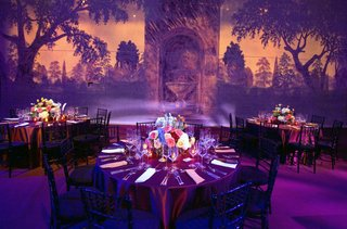 garden-backdrop-and-reception-tables-with-purple-lighting