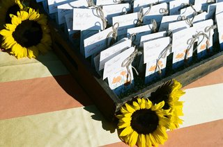 tables-assignments-in-wood-crate-with-sunflowers