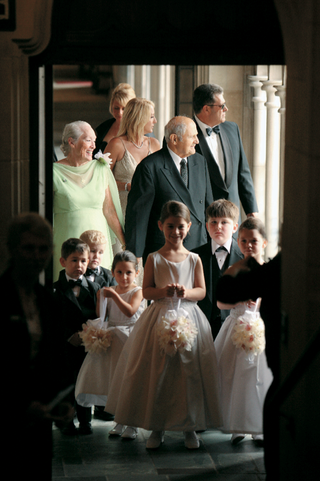 children-at-entrance-of-church-with-grandparents