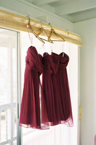 magenta-wine-colored-gowns-hanging-on-hangers