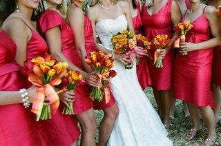 bride-and-bridesmaids-carry-vibrant-nosegays