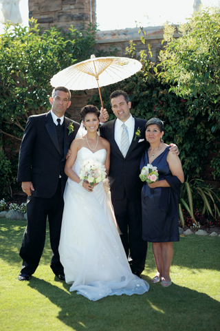 bride-and-groom-with-family-members
