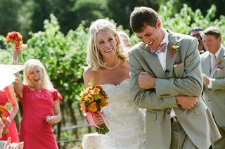 couple-laughing-during-recessional