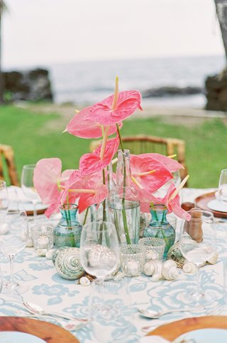 sea-glass-vases-filled-with-pink-anthuriums