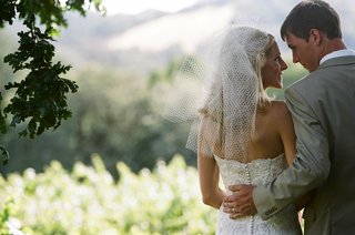 bride-in-french-net-veil-and-lace-wedding-dress