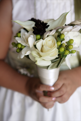 flower-girl-holding-small-nosegay-of-flowers