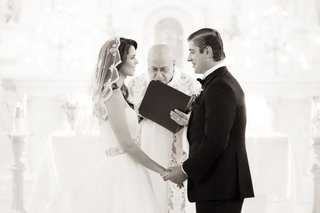 brandon-dubinsky-and-bride-stand-at-altar-during-catholic-ceremony