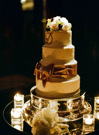 four-layer-wedding-cake-dotted-with-pearls