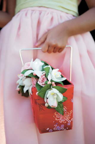 oversized-takeout-box-filled-with-flowers-for-flower-girl