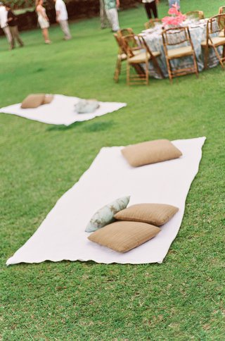 beach-towels-on-grass-next-to-reception-tables
