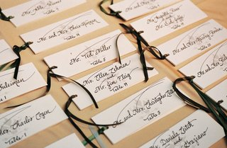 handwritten-place-cards-tied-with-ribbon