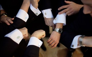 groomsmens-hands-showing-off-mens-jewelry-cufflinks