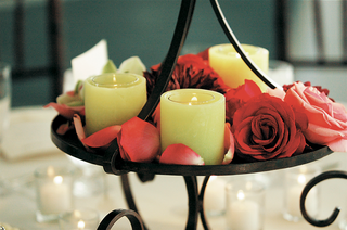 cherry-florals-and-yellow-candles-on-centerpieces