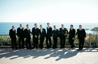 groomsmen-stand-in-front-of-ocean-background