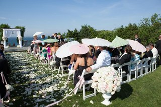 ceremony-guests-hold-multicolored-parasols-at-wedding