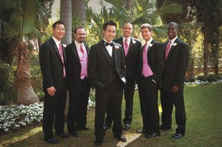 groomsmen-wear-black-suits-with-pink-ties-and-vests