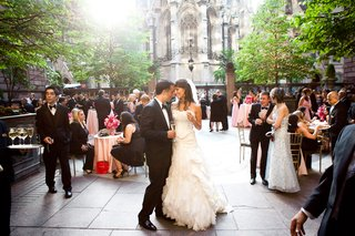 bride-and-groom-holding-champagne-outside