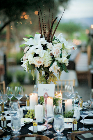 wedding-reception-centerpiece-with-white-flowers-and-grapes