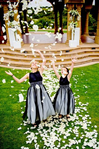 two-flower-girls-throwing-ivory-petals