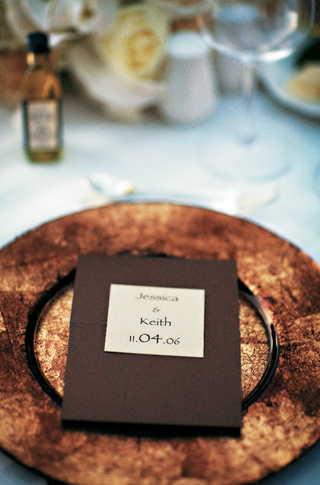 wedding-menu-on-top-of-golden-charger-plate