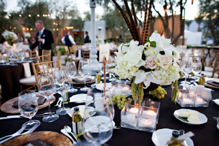 wedding-reception-centerpiece-with-feathers-and-grapes
