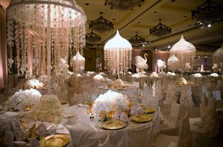white-tables-and-chair-covers-with-floral-centerpieces