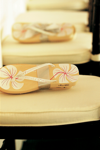 flip-flops-tied-with-ribbon-waiting-on-guest-chairs