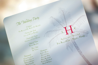 white-wedding-program-with-green-lettering-and-palm-tree-drawing