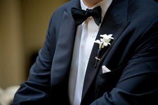 stephanotis-blossoms-wrapped-in-black-ribbon