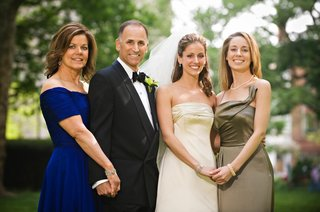 bride-in-a-monique-lhuillier-gown-with-family