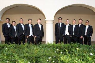 groom-with-groomsmen-in-black-suits-and-ties