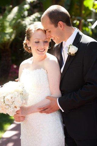 jewish-couple-in-wedding-attire-outside