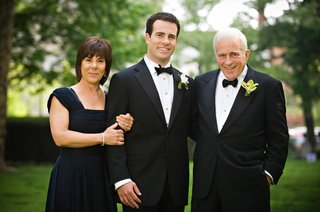 groom-in-a-tuxedo-with-parents
