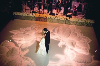 flower-design-projected-in-pink-on-wedding-dance-floor