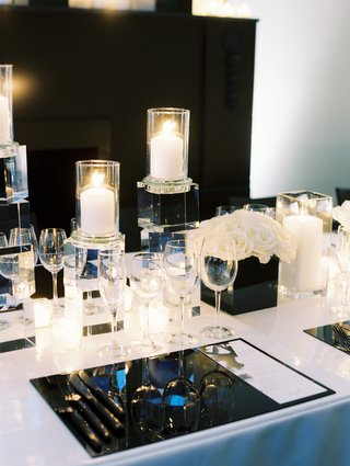 modern-chic-black-and-white-wedding-tablescape-with-white-linens-and-gunmetal-lucite-placemat