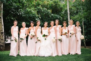 bride-with-bridesmaids-wearing-one-shoulder-dresses